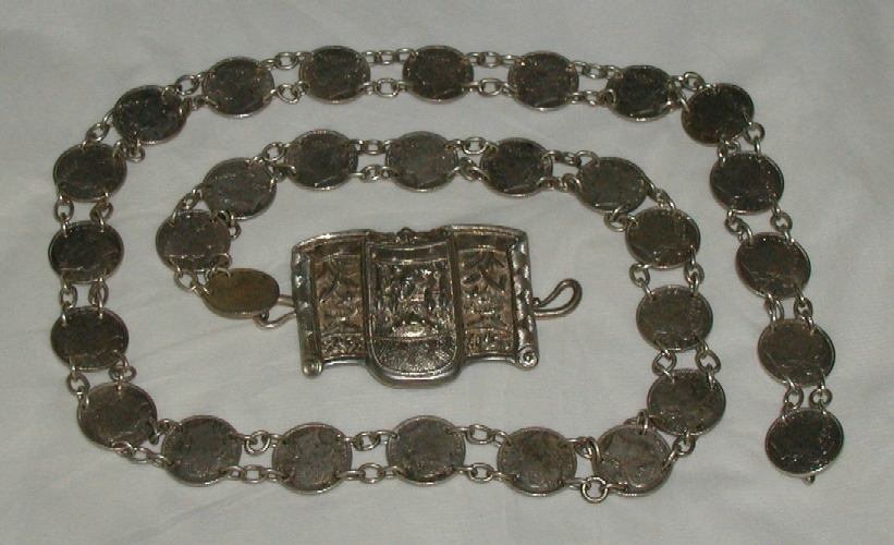 Peranakan silver belt with coins.