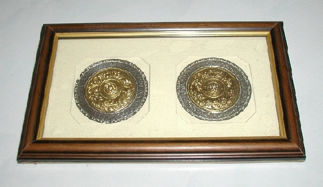 Pair of gold & silver pillow ends framed